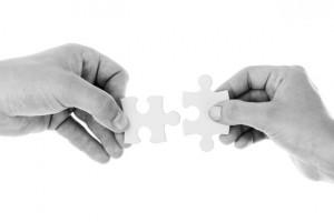 hands-holding-jigsaw